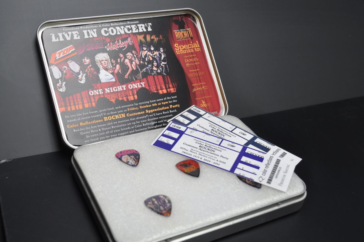 custom made guitar picks and a commemorative case
