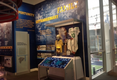 wall graphics and a display case of football memorabilia